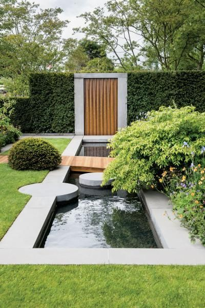 Artistic water feature using concrete and wood for Concrete pond design