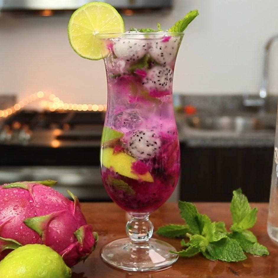 Dragon Fruit Mojito #simplemixeddrinks The Dragon Fruit Mojito is one of the tastiest variations on the classic Mojito recipe we've ever tried. This beautiful, fruity mixed drink combines coconut rum, simple syrup, lemon-lime soda, dragonfruit, lime wedges, and mint leaves, and tastes like a refreshing burst of relaxing island life. #simplemixeddrinks Dragon Fruit Mojito #simplemixeddrinks The Dragon Fruit Mojito is one of the tastiest variations on the classic Mojito recipe we've ever tried. Th #simplemixeddrinks