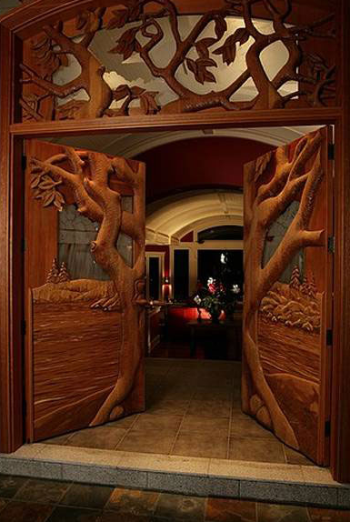 Stunning custom made hand carved door with an for Hand carved wood doors