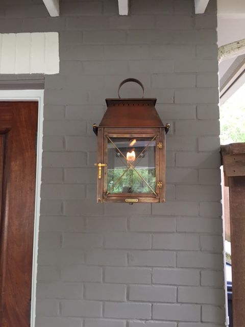 Gray Hues Are In And This Coach House Bevolo Lantern Compliments The Home S Brick Exterior Ni Exterior Light Fixtures Copper Outdoor Lighting Copper Lighting