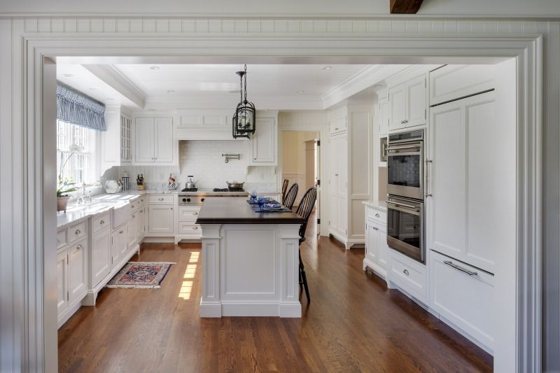 A Traditional U Shaped Kitchen In Concord Ma With Custom Cabinetry And Built In Appliances Carriage House Plans Carriage House Doors Traditional House