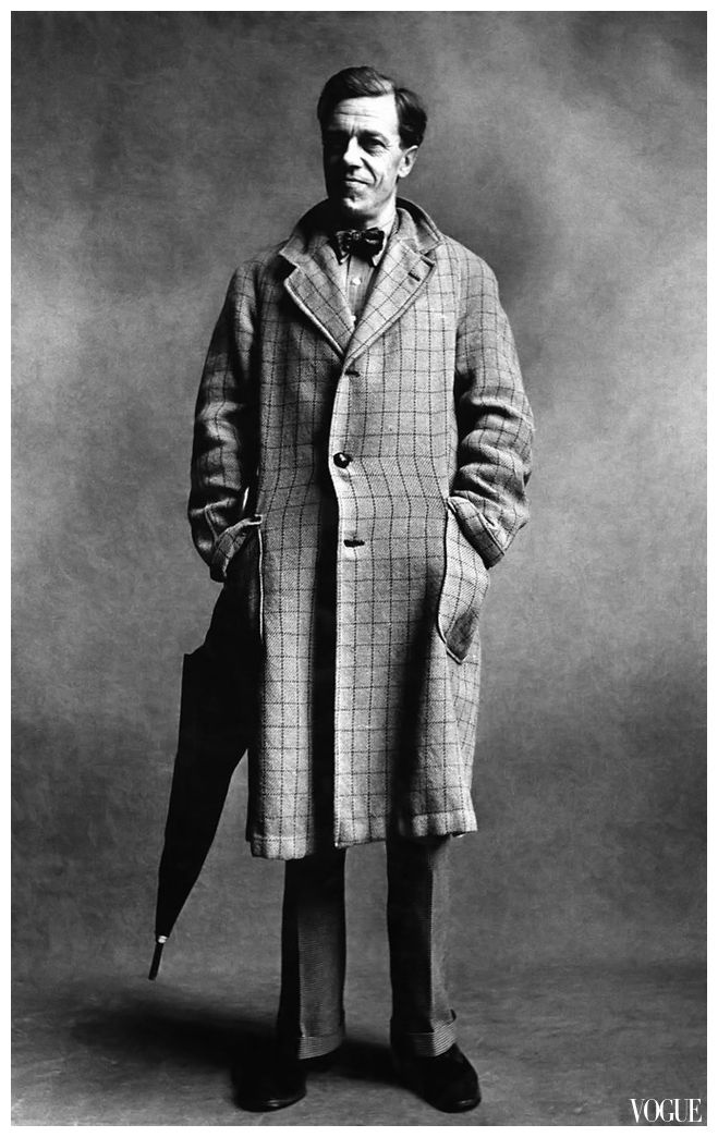 Cecil Day Lewis, poet, wearing a three-button, checked overcoat, hands in the pockets, with an umbrella Condé Nast photo by Irving Penn from the Book Nostalgia in Vogue 1951