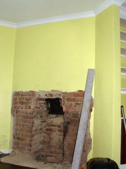 The Fireplace With The Builders Opening Cleared Out Up To The Bottom
