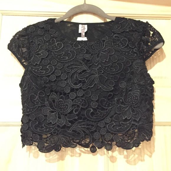 Black lace crop top with cap sleeves, Small zipper on side to help with putting on , this top has lining under the lace ...  Model is not wearing top listed , pictures only shown for outfit inspiration ... Tops Crop Tops