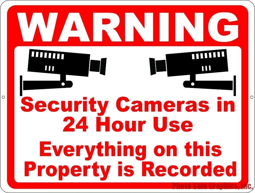 warning security cameras in 24 hour use sign inform