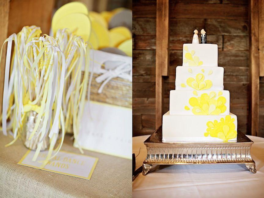 Yellow bridal wands and bright yellow wedding cake