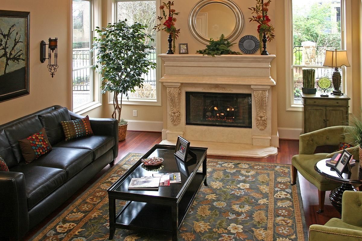 This living room offers a mix of traditional style with contemporary. The punches of color add a fun flair to the room.