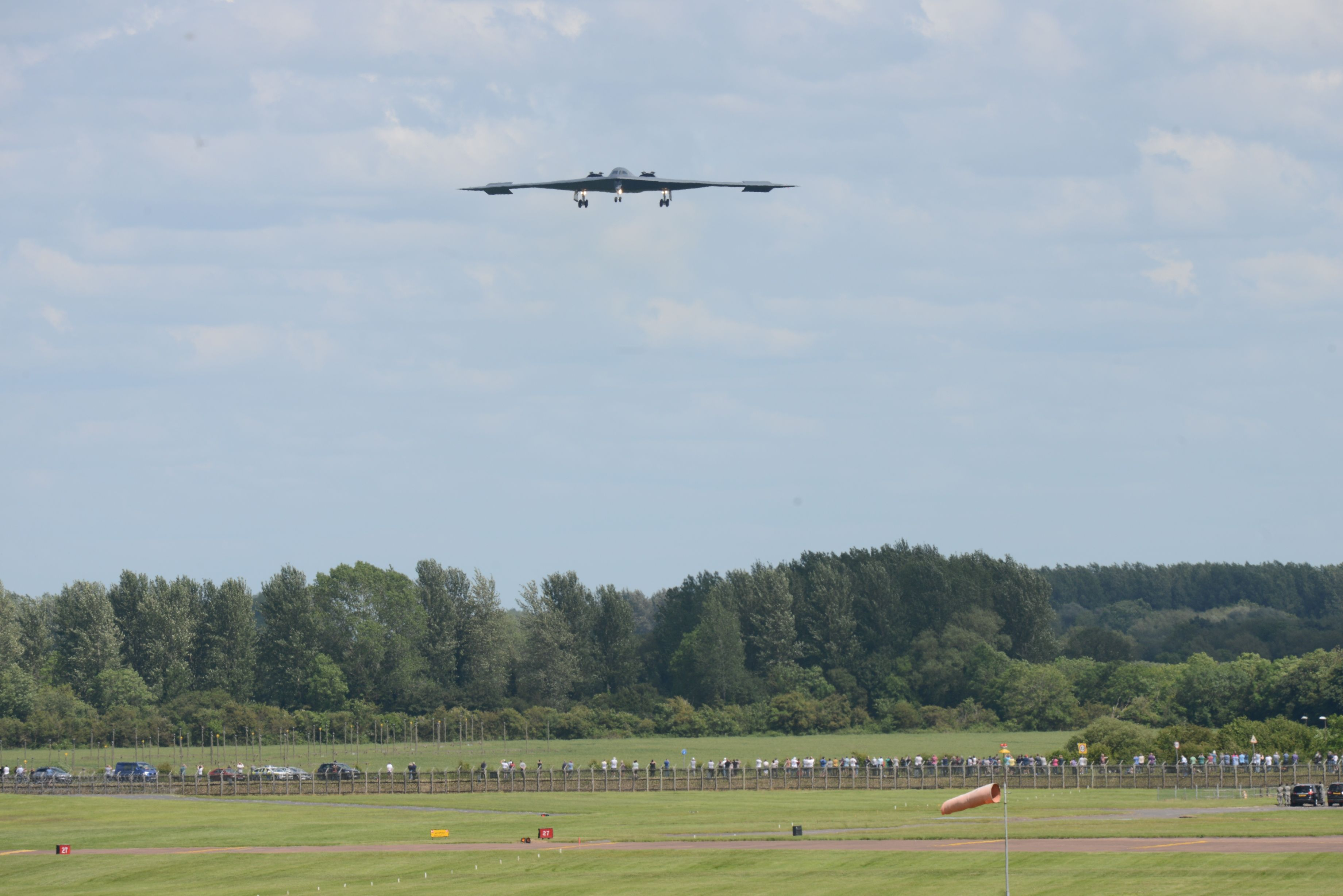A B-2 Spirit from the 509th Bomb Wing, Whiteman Air Force Base, Missouri, prepares to land on the runway at RAF Fairford, England, June 8, 2014. The B-2 Spirit is a multi-role bomber capable of delivering both conventional and nuclear munitions. (U.S. Air Force photo by Tech. Sgt. Chrissy Best/Released)