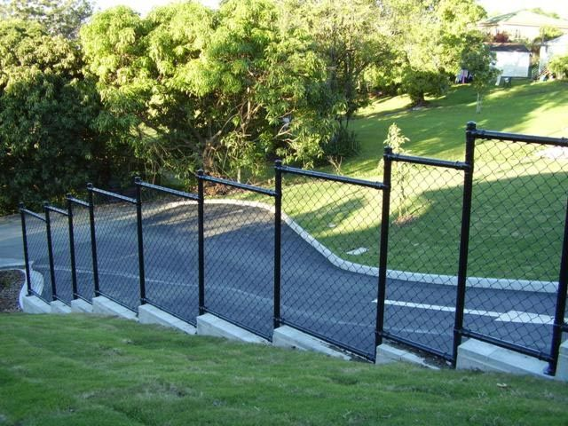 This Black Pvc Fence Is Stepped To Go With The Slope Of