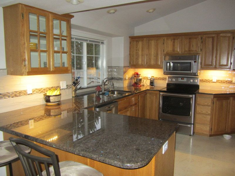 Kitchen Remodel With New Countertops In Labrador Antique 3cm Granite This Is A Beautiful Granite With Blue Stone New Countertops Kitchen Remodel Countertops