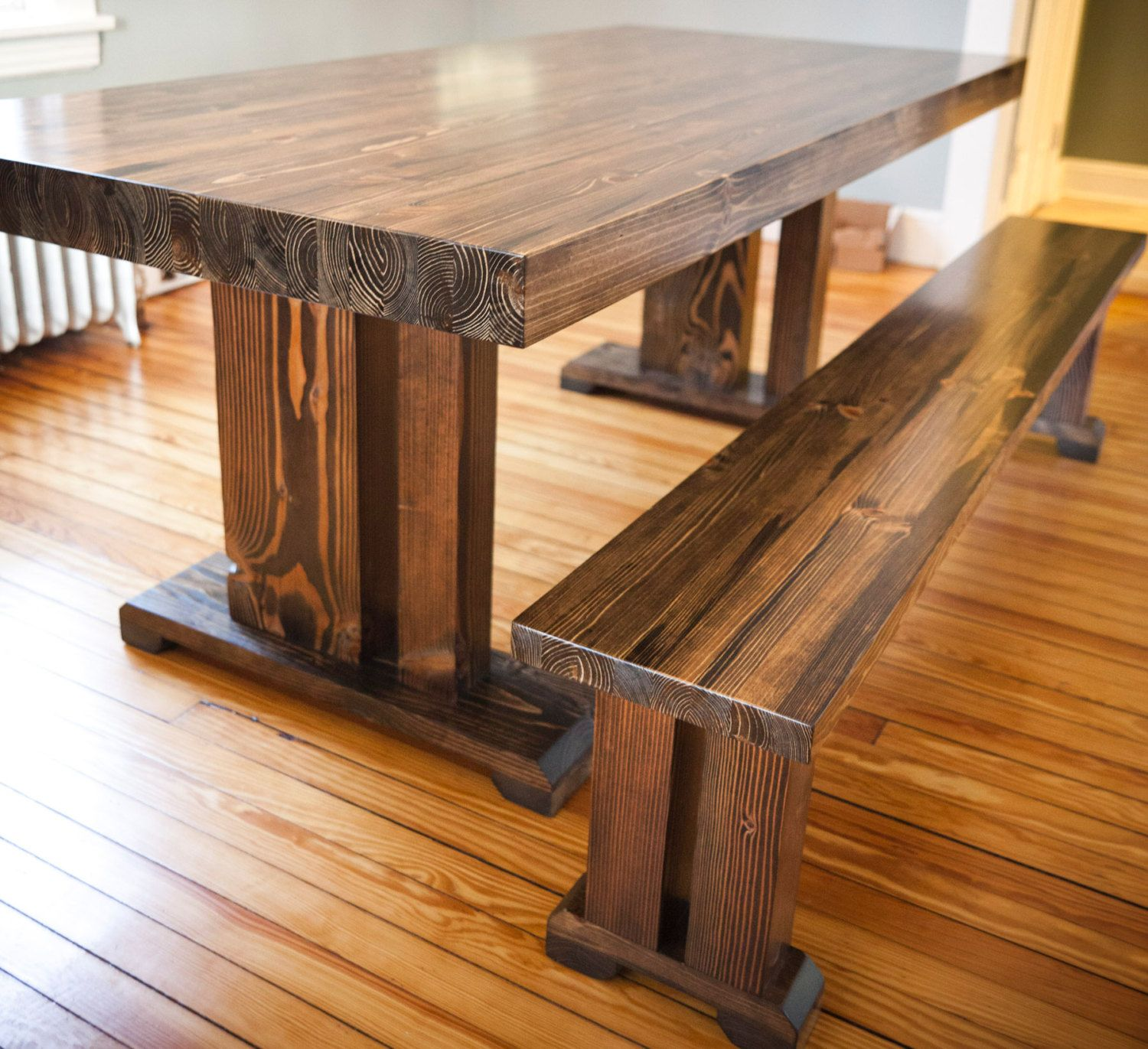 Farm style wood dining table with well made solid