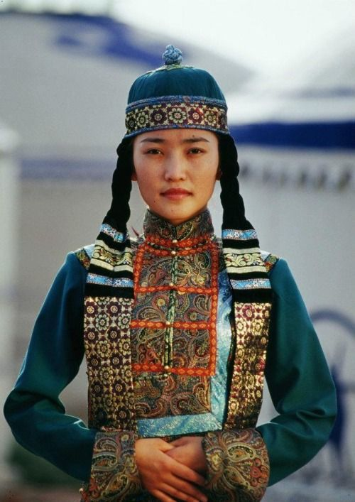 Portrait of a woman in traditional clothing of Mongolia