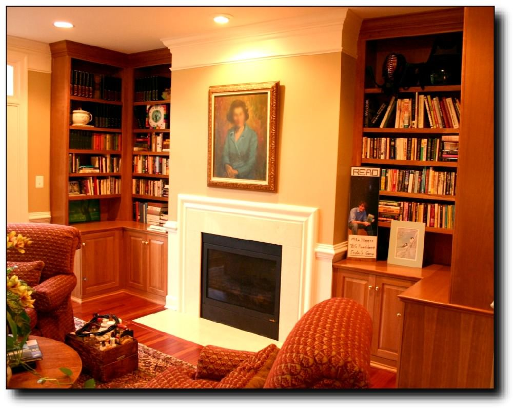 Fireplace surrounds with bookcases cherry cabinets surround