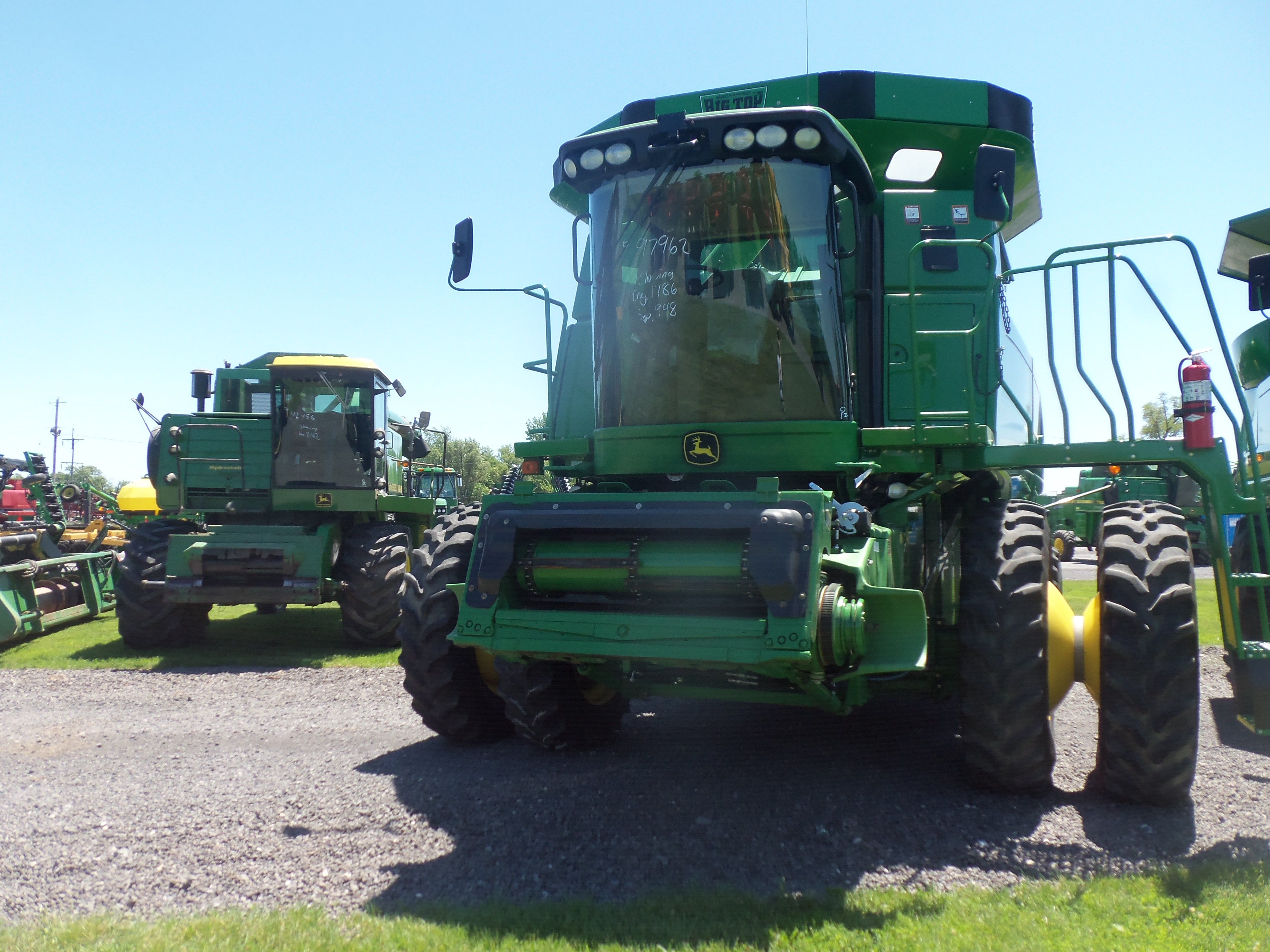 Front of JOhn  Deere 9770 STS Bullet Rotor with Turbo 6620 in background.THis shows how JOhn  Deere combines changed from 1978 to 2007