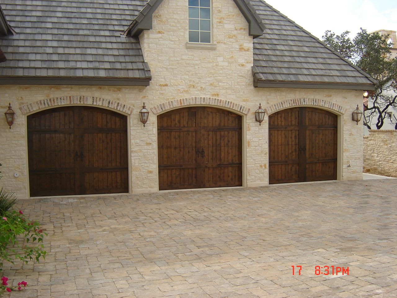 Love black garage doors on a brick detached garage exteriors cobble stone driveway and arched garage door rubansaba