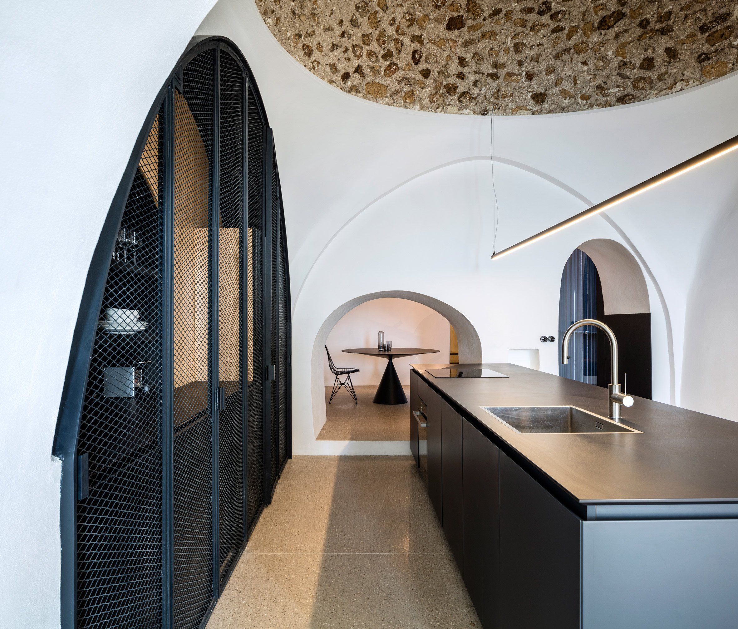 Pitsou kedem has updated an apartment in the ancient port of jaffa tel aviv adding arched windows and door frames to echo the vaulted ceiling