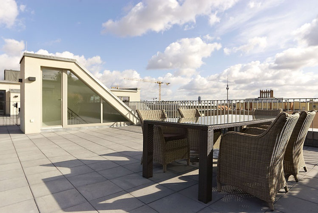 Dine above it all from your own private rooftop patio.
