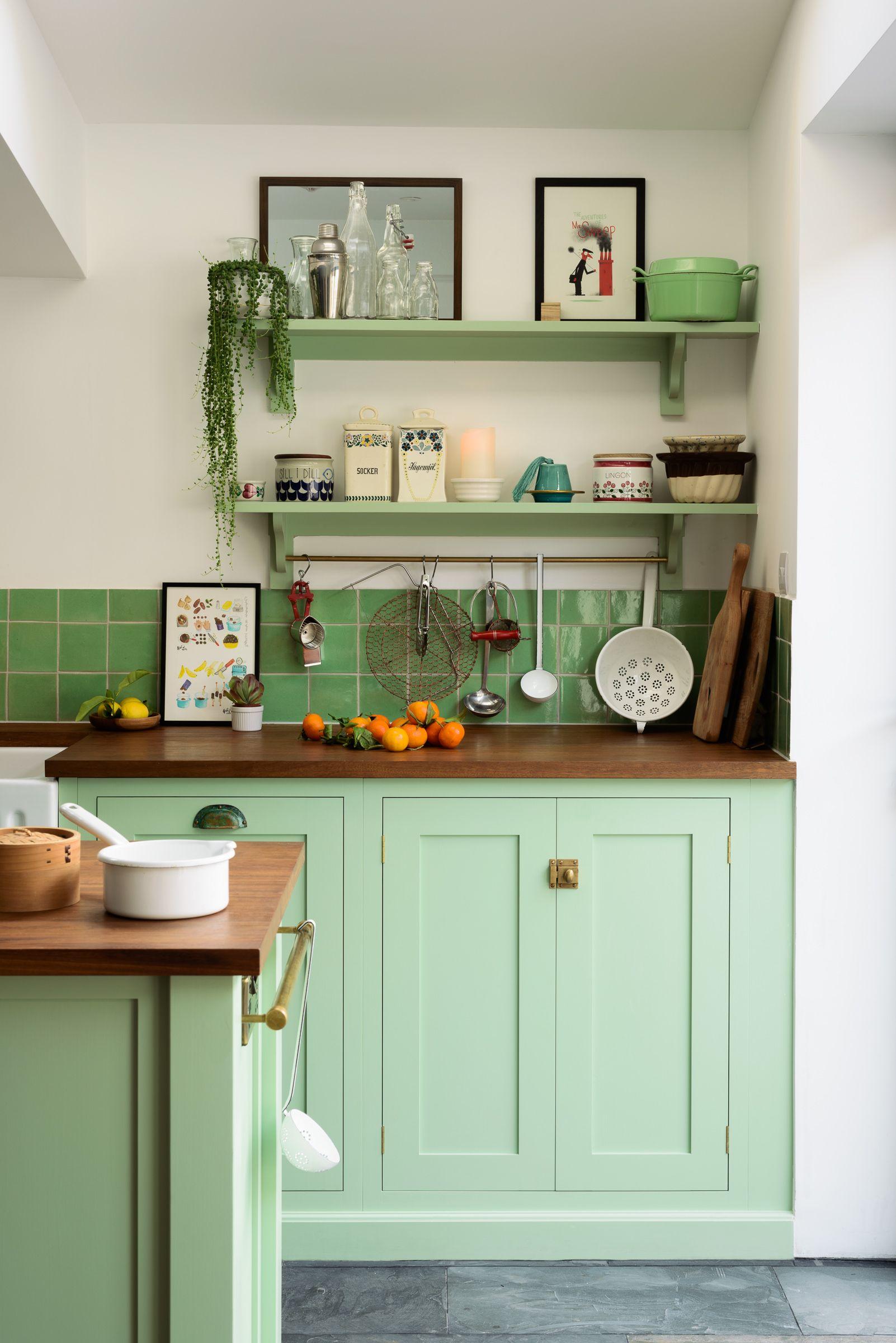 Beautiful green deVOL cupboards, brass hardware and a dark grey ...