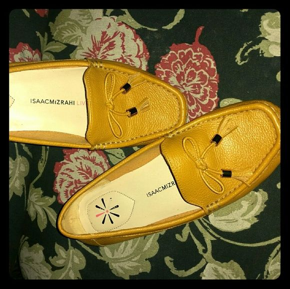 Isaac Mizrahi Live!  Leather Moccasins Pebble Leather Moccasins in Goldenrod. Worn once or twice. These belong to my mother, so I can't say why she's wanting to sell. If they were my size I'd buy from her in a heartbeat!! Sz. 6M.   *These are best sellers for QVC. There aren't any of this size left on website. Isaac Mizrahi Shoes Moccasins