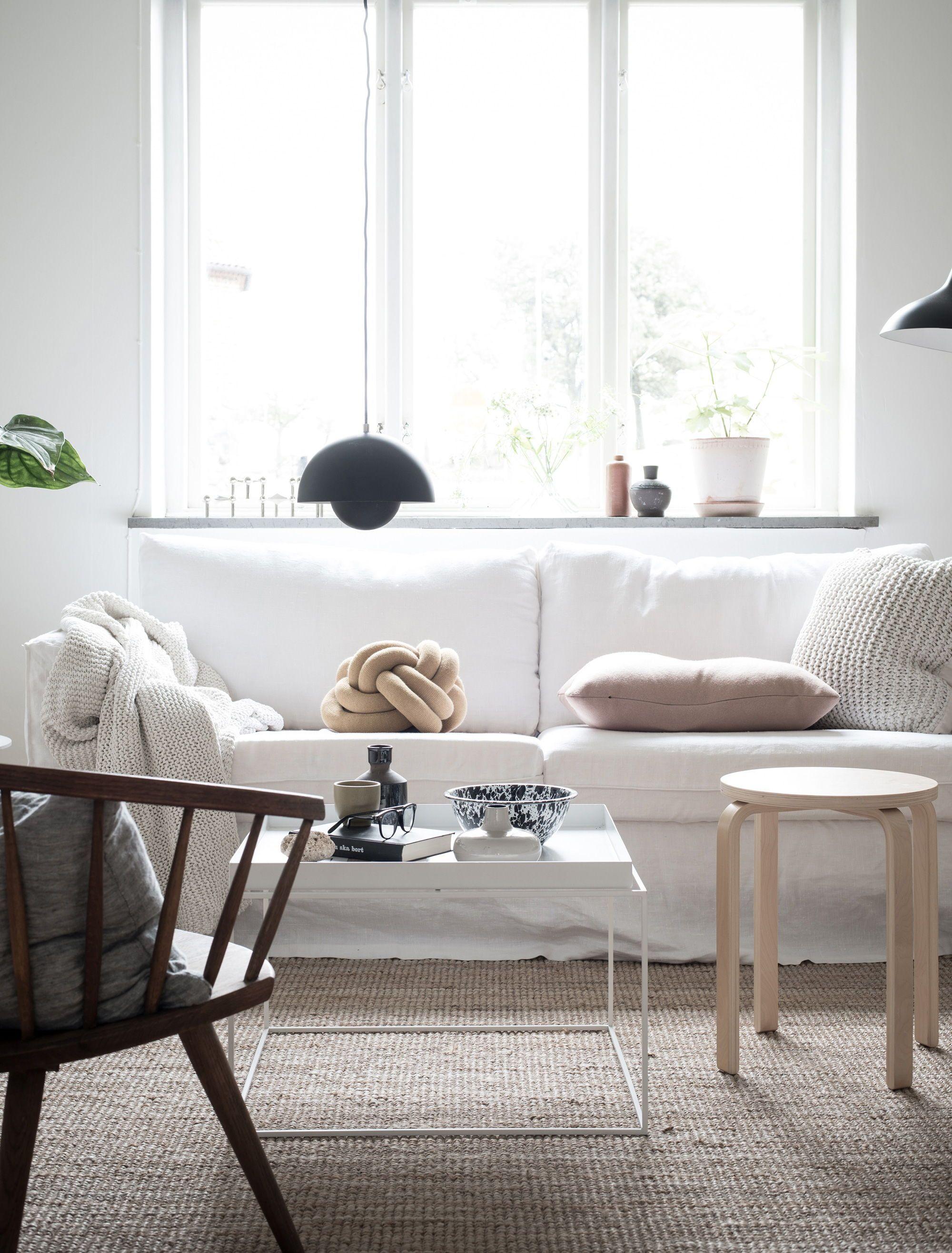 White Scandinavian Minimalism White Linen Sofa Black Accents Add A Modern G White Furniture Living Room Minimalist Living Room Decor Minimalist Living Room