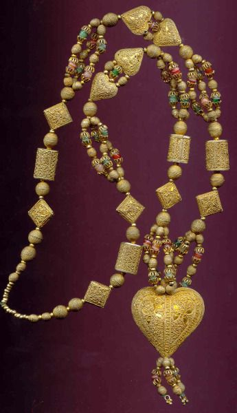 Heart necklace or du pays. Intricate silver-gold beads combined with little Bohemian glass beads, . Senegal 1930s. Posted by Annmarie KOGLER