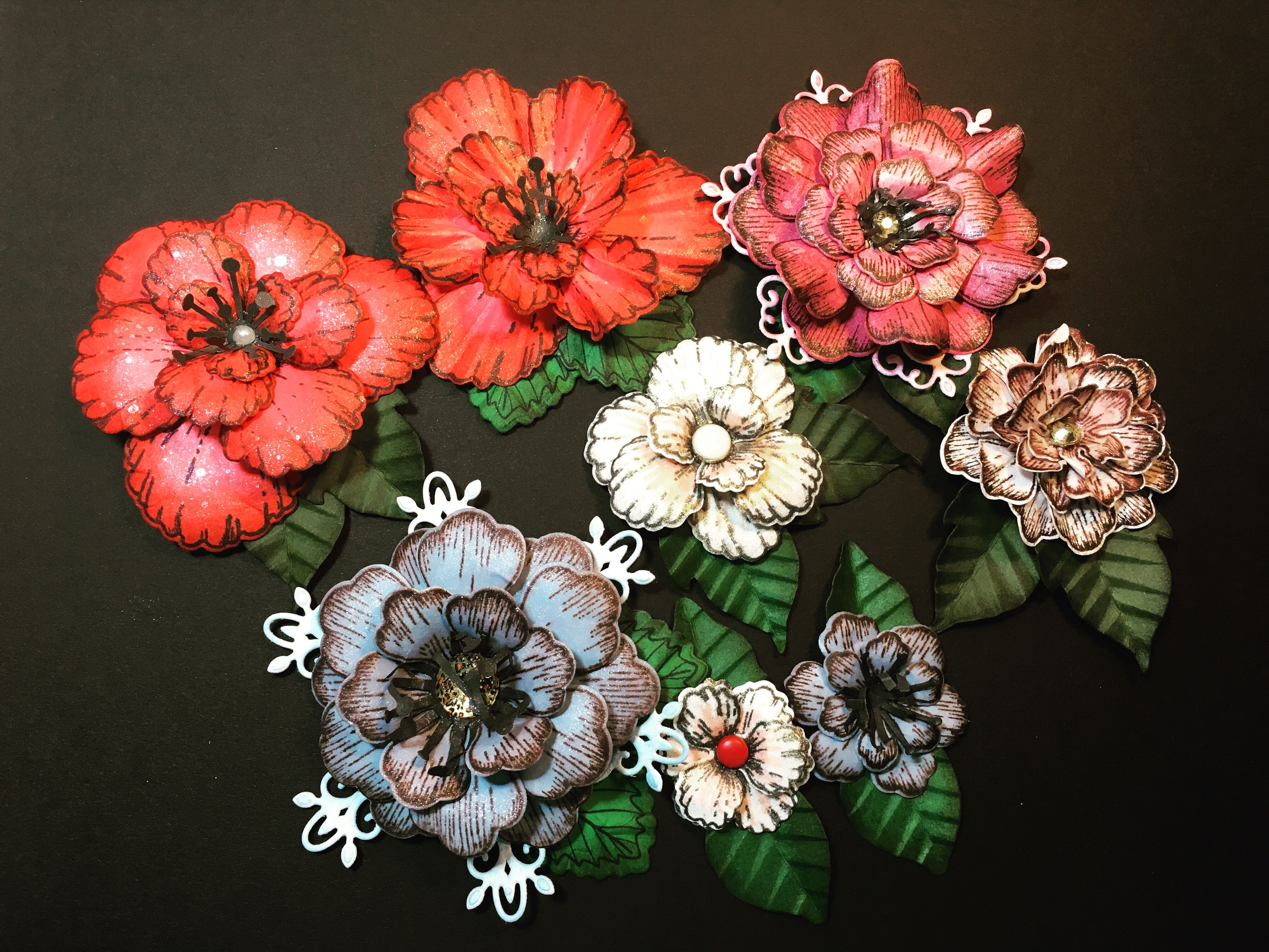Paper flowers made with Heartfelt Creations stamps.