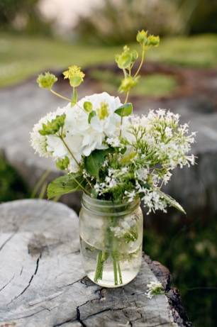 Mix And Match Flowers And Put Them In Jars On The Table For Low Centerpieces That Make A Statement East Coast Wedding Wedding Table Decorations Flowers Bouquet