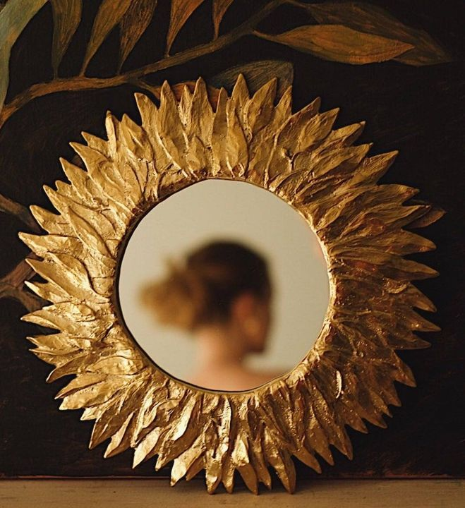 This gilded brass mirror featuring a beautiful sunflower foliage detail is a must for fall, or any season.