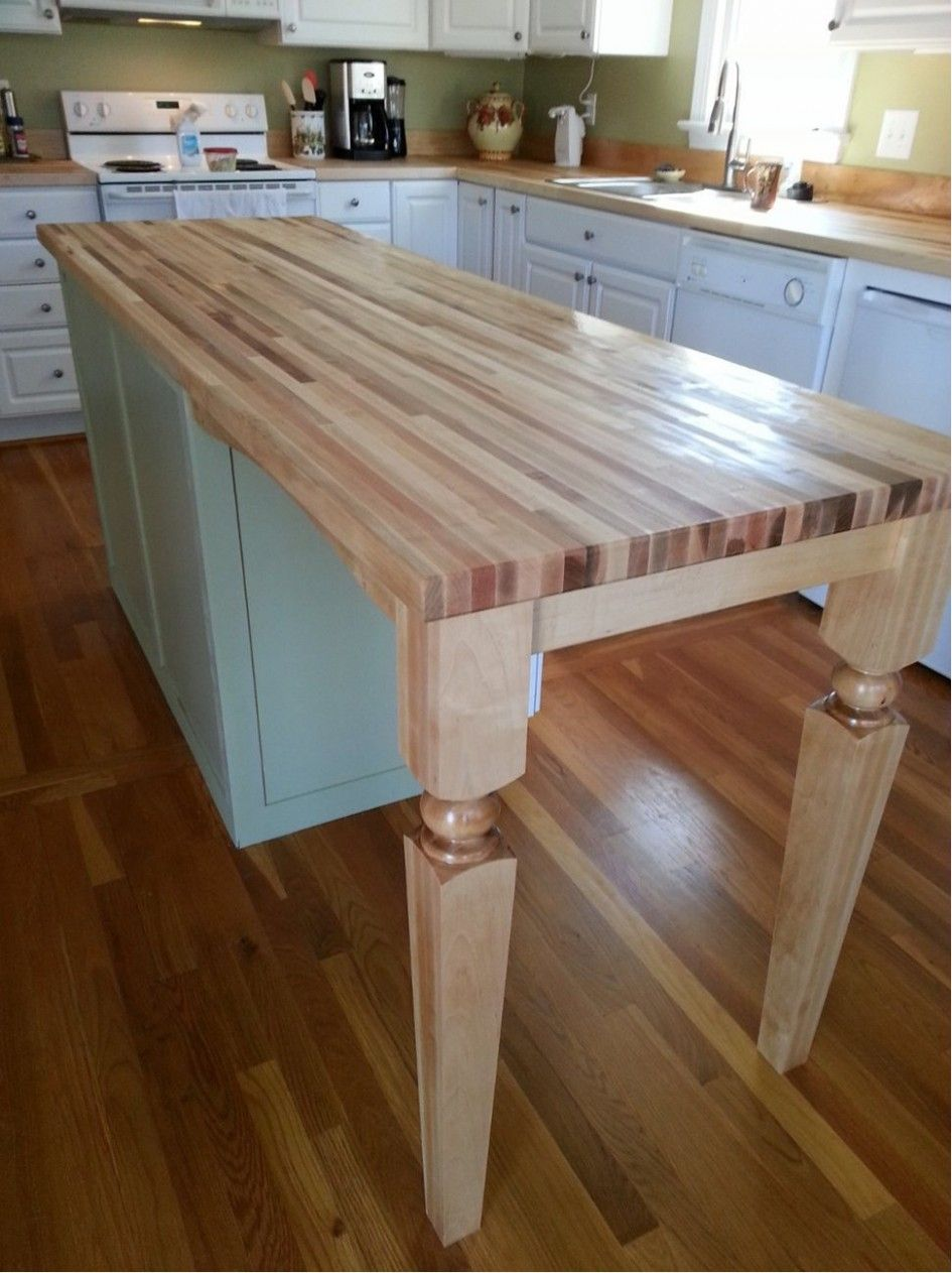 Striking Wooden Kitchen Island Legs With Custom Butcher Block Countertops Also White Kitchen Cabinets Re Kitchen Design Wood Kitchen Island Kitchen Work Tables