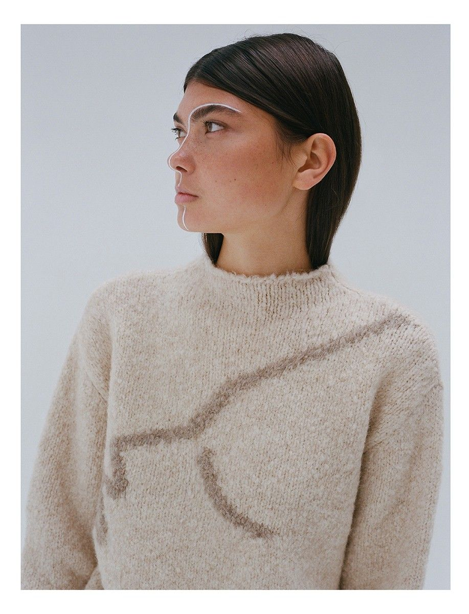 Paloma Wools Virgo Sweater With An Intarsia Face Contour Line