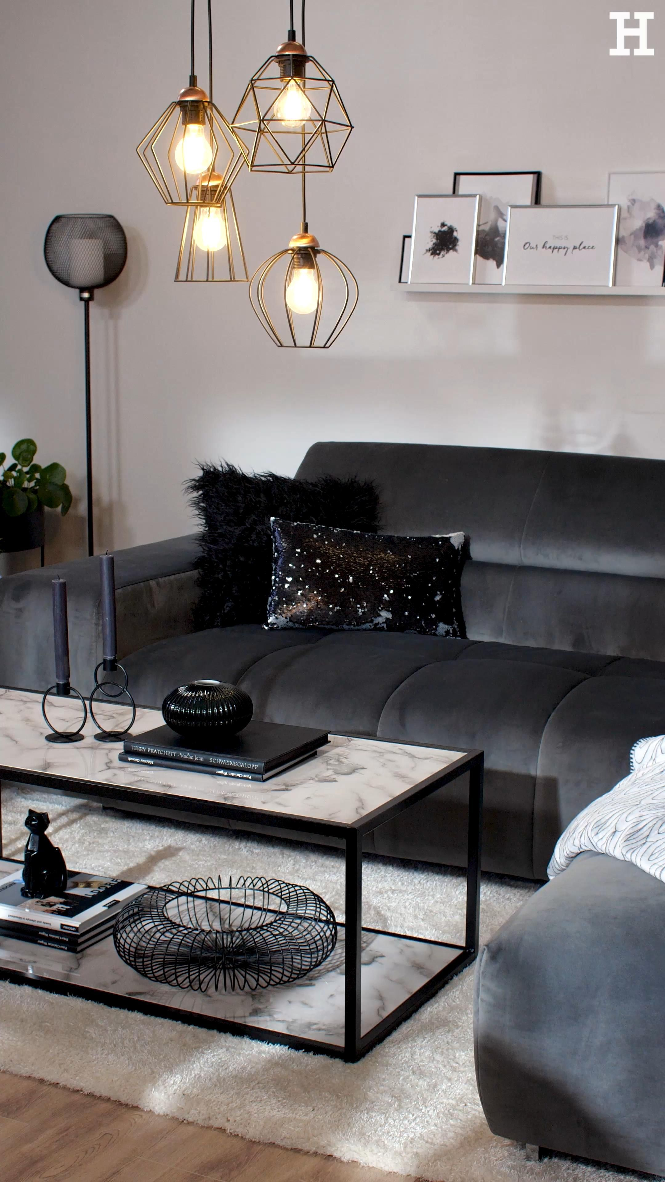 Photo of Luminaires with filigree metal struts in black fit seamlessly into the monochrome look