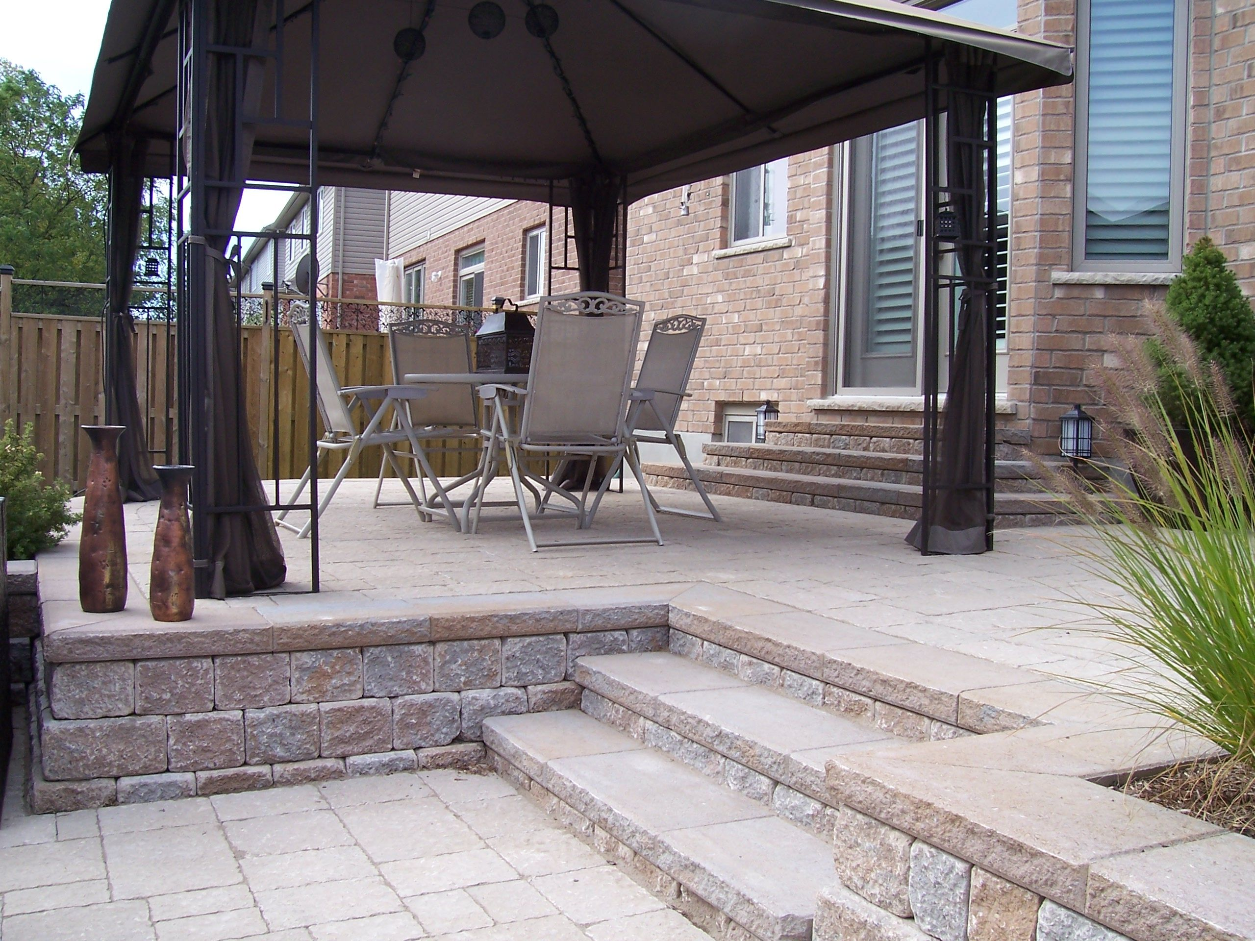 Multi level backyard patio and stone stair case for Multi level patio designs