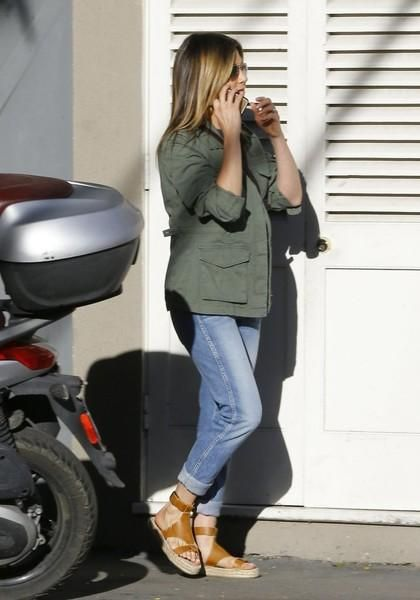 Jennifer Aniston wearing the Row Hunting Bag, Oliver People x The Row Executive Suite Photochromic Aviator Sunglasses and Soludos Espadrille Sandals in Camel