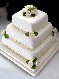Three Tier White Square Wedding Cake Beautifully Decorated With Handmade Sugare Flowers And Intricately