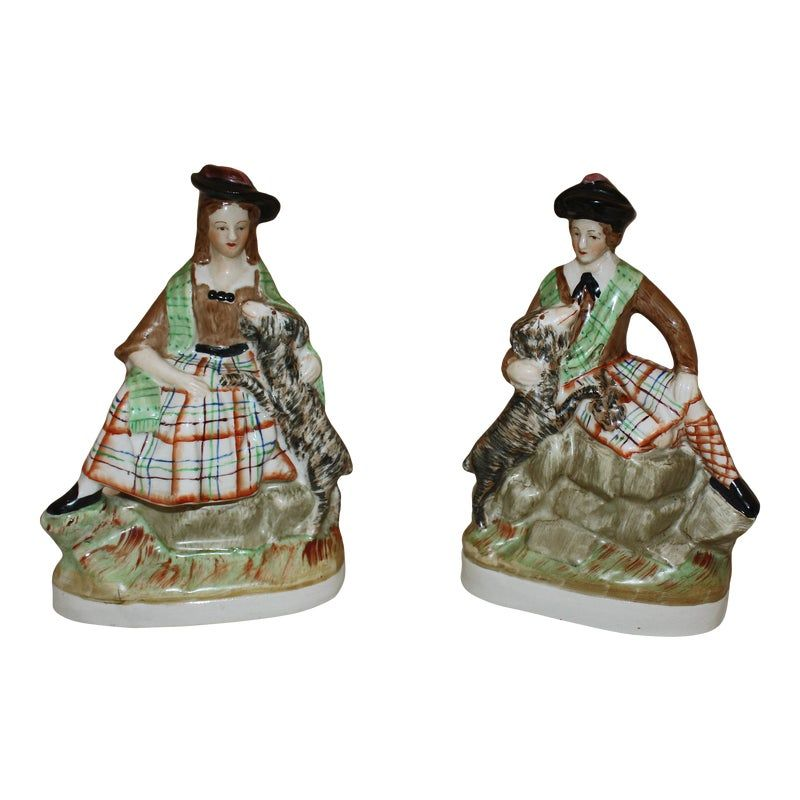 A wonderfully painted pair of c.1860 Staffordshire figures of a Scottish Lad & Lassie. Each measures: 4