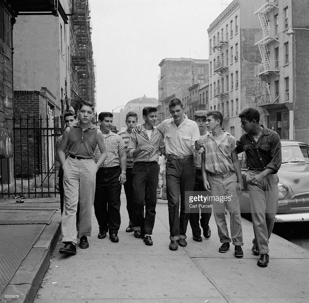 A Teenage Gang Walking Along Street In New York City In
