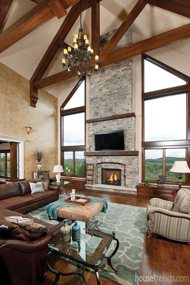 Soaring 30 Foot Tall Cathedral Ceilings Carved Wood Beams And Stone Accents Establish The Traditional Feel In This Pittsbu Great Rooms Rustic Family Room Home
