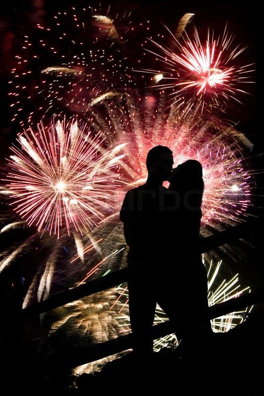 2188530 A Silhouette Of A Kissing Couple In Front Of A Huge Fireworks Display Jpg 533 800 Fireworks New Years Eve Kiss New Year S Kiss