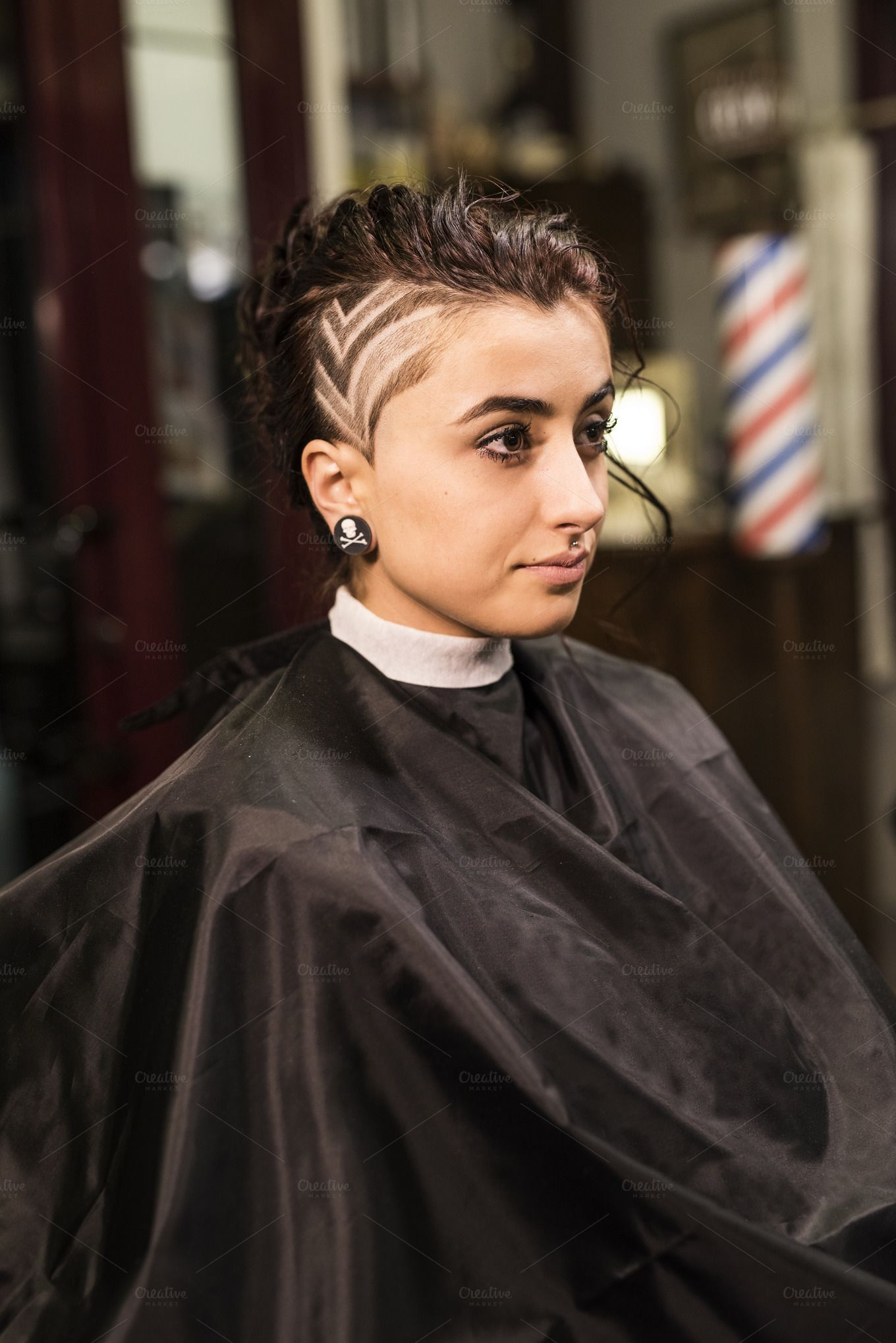 woman in barber shop with hair tattoo hairstyle