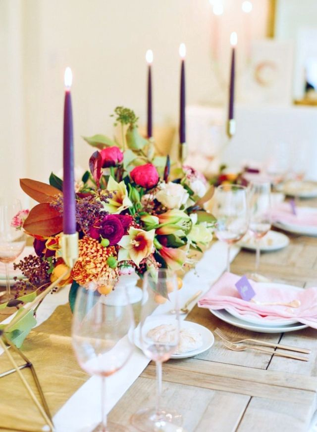 Cheery flora arrangement and the bright candles make this table the happiest of Thanksgiving tables! Ideas for a Unique Thanksgiving Tablescape | Musings on Momentum