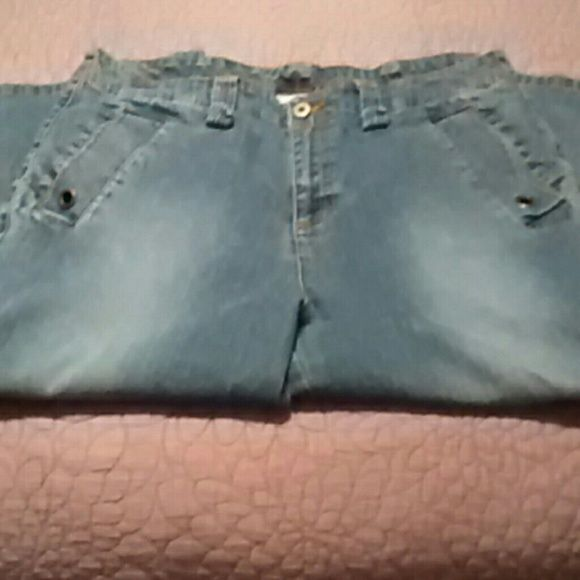 Size 16 Denim Capris Denim capris 56% Ramie 25% Cotton 17% Polyester 2% Spandex. Pockets with buttons on both legs and a zipper on the pocket on the right leg. 19 and 1/2 inch inseam. 30 inches from waist to hem. In excellent condition. Carolina Blues Jeans Ankle & Cropped