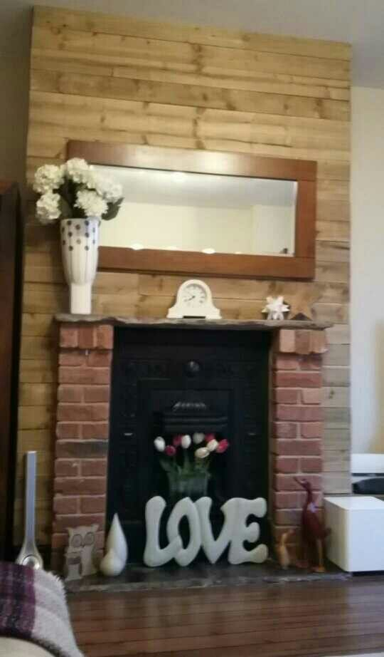 Wooden cladding on chimney breast wall.
