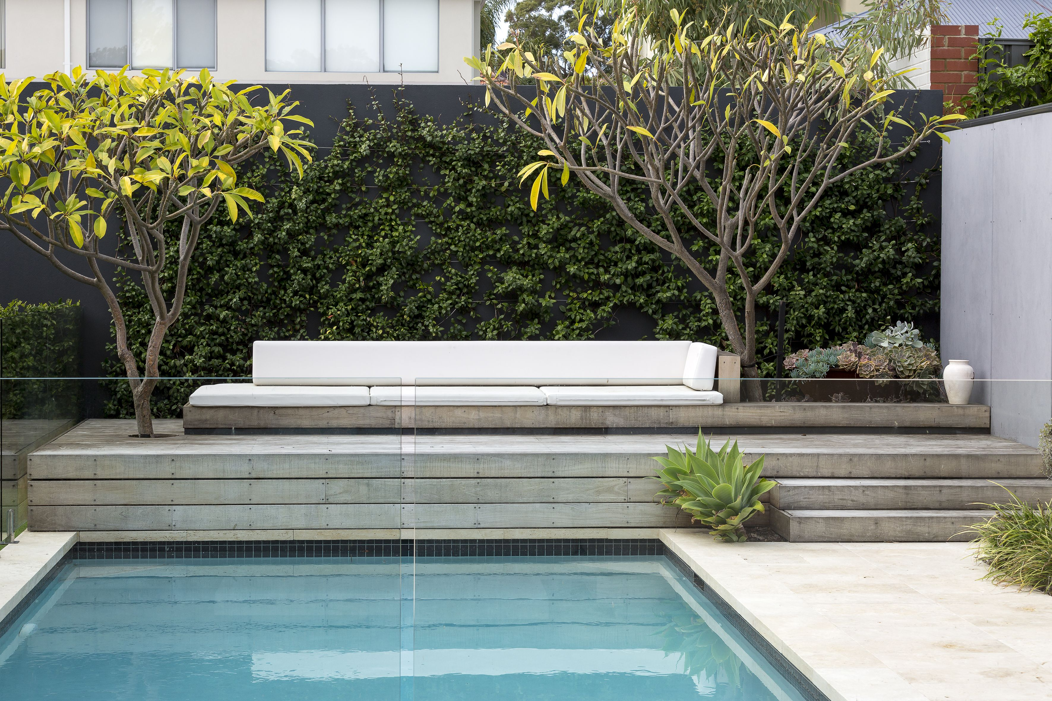 pool decking designed to hide pool cover holding an outdoor built