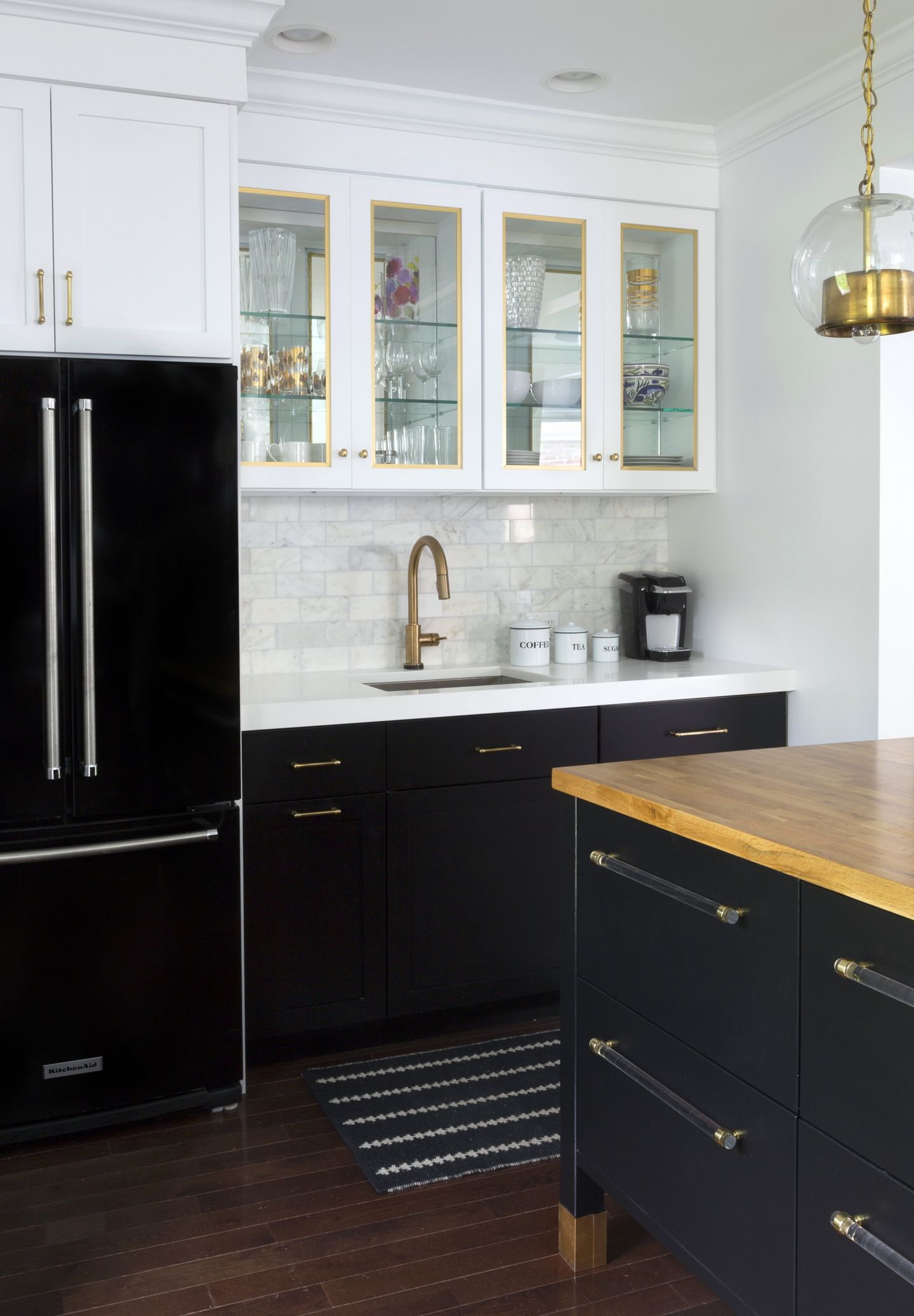 Black Refrigerator With Black Base Cabinets And White Upper Cabinets Marble Subway Tile Brass