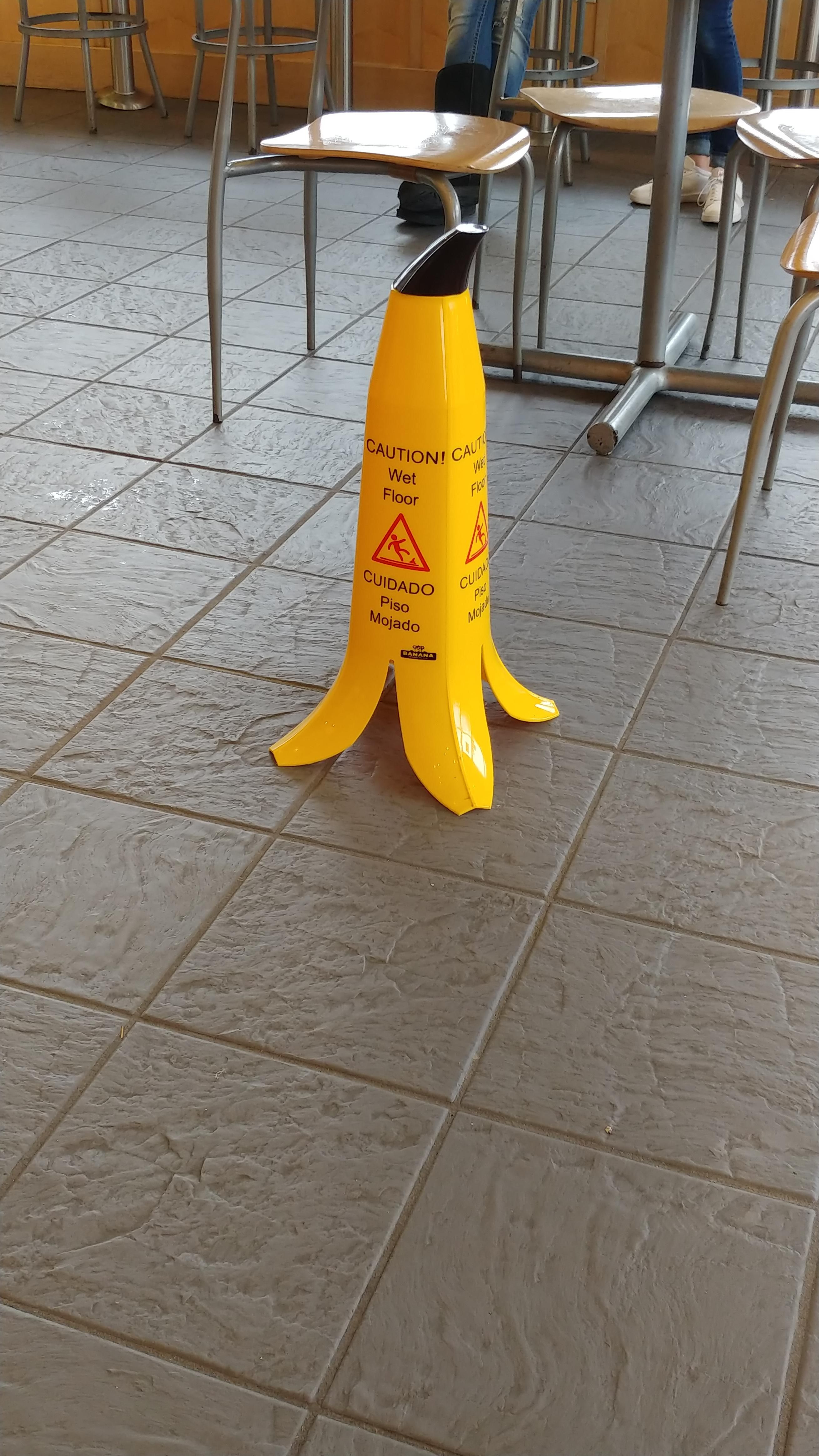 This Wet Floor Sign Looks Like A Banana To Indicate Slippery When Wet