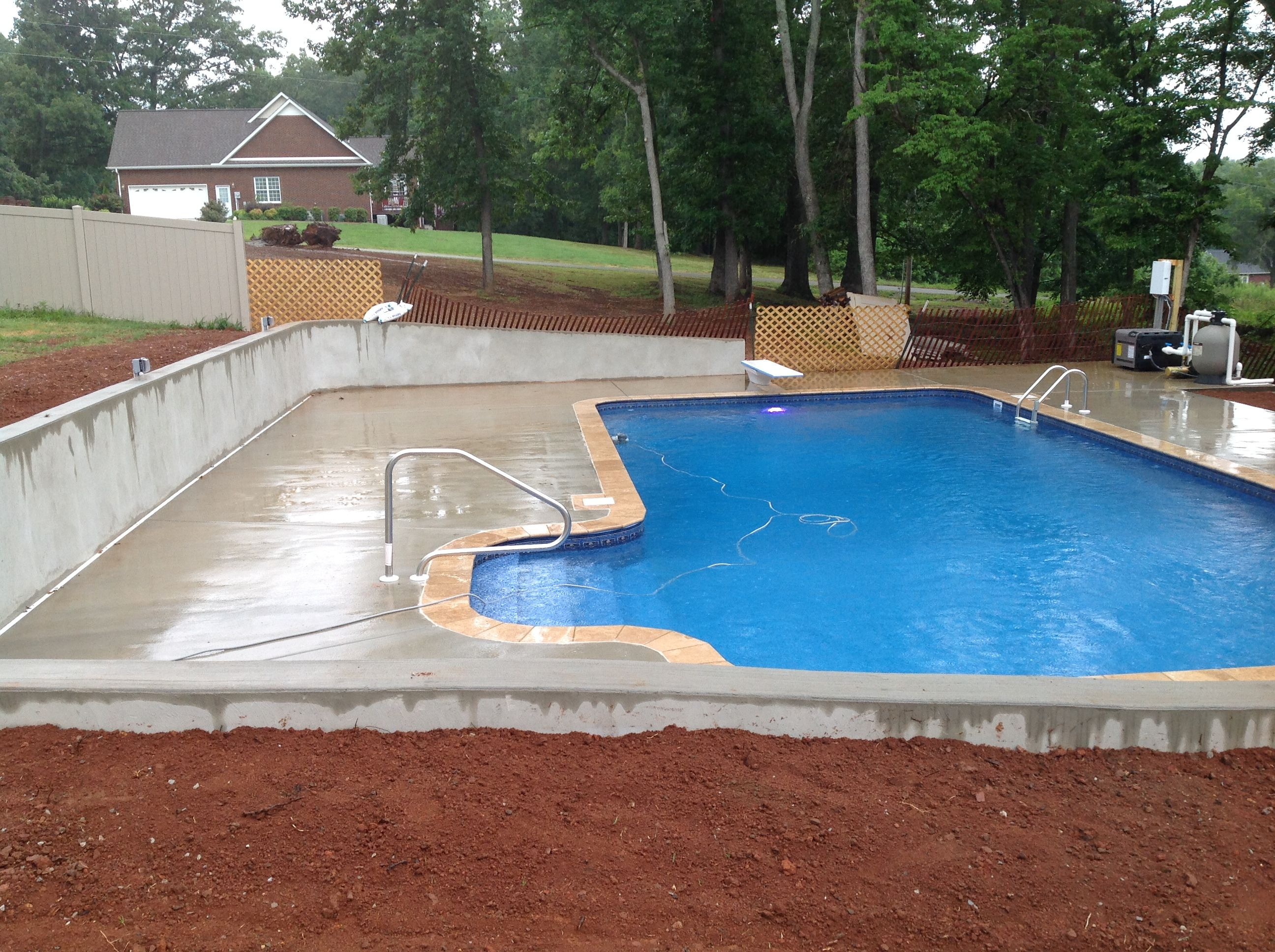 An Idea For Yards With A Slope Concrete Wall Pool With A Concrete Retaining Wall Concrete Retaining Walls Pool Landscaping Backyard Pool