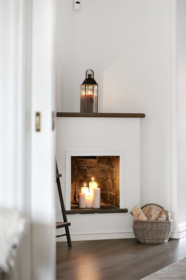 small simple corner fireplace with deco lantern!