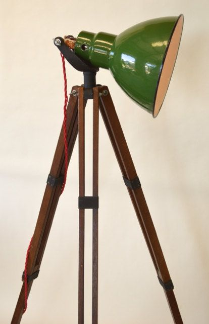 We created this incredible lamp by repurposing a vintage wood tripod and adding a reclaimed industrial style green shade. The lamp was wired using