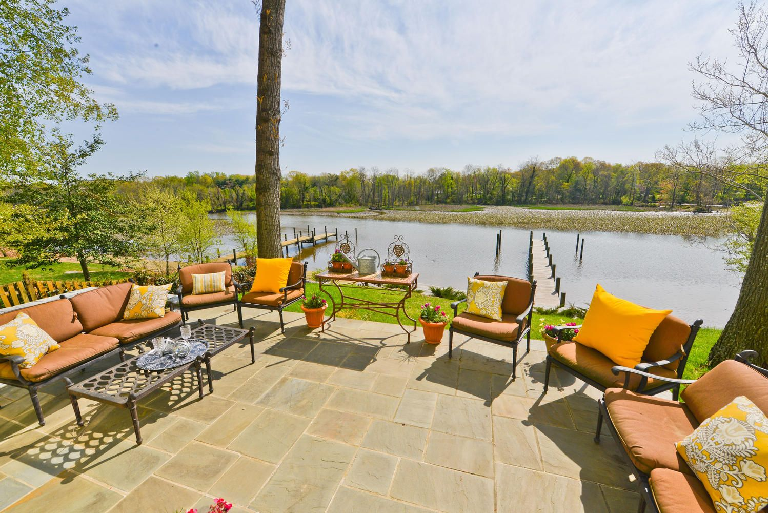 Gorgeous patio overlooking river at our Woodland Lane property