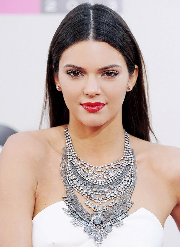 Kendall Jenner stunned on the red carpet with a glossy red pout and her center-parted hair pulled back.